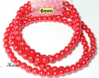 1 strand 82cm = 152 red glass beads 6 mm (806.21.1)