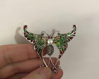 An Art Deco plique a jour enamel butterfly brooch#pendant#a gem set and plique a jour enamel brooch pendant