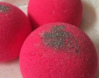 Bombshell hot pink shea butter bath bomb... Great gift!!  4.5 ounces