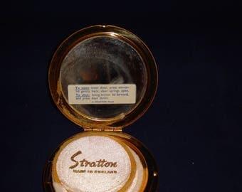 Stratton powder compact