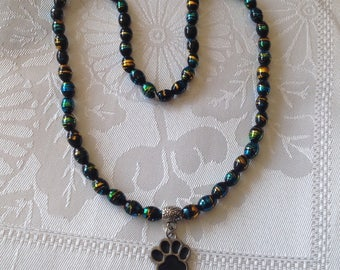 Elastic necklace oval beads cosmic and cat paw charm