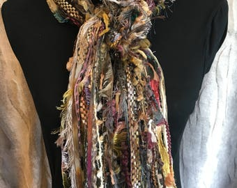 Unique fashion scarf in shades of green, pink, taupe, cream, gold and purple.