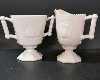 Vintage pink milk glass sugar and creamer set. Jeannette glass. Pedestal,  pear design
