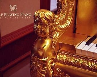 ornate self playing steinbecker gold grand piano