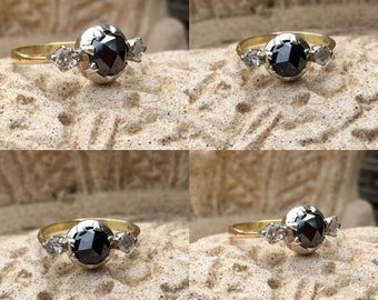 18ct and silver 1.5ct black diamond and double diamond solitire ring
