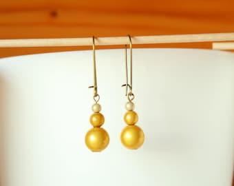 Earrings sleepers beads magic yellow gold and beige