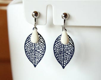 Clip earrings featuring a Navy Blue filigree leaf and sequin drop enamel creamy white
