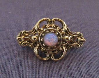 Small Gold Tone Pin of Intricate Design