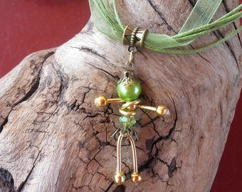 Doll, green, gold and bronze pendant necklace
