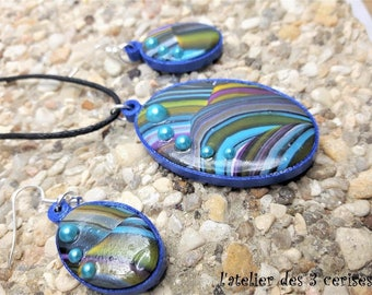 Blue oval ornament polymer clay and quilling