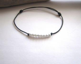 Cord bracelet white pearls