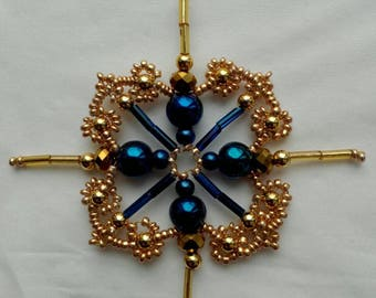 Four-pointed star for the Christmas tree. Ornament in golden-blue tones. Winter festive decor. New Year's gift. Handmade.
