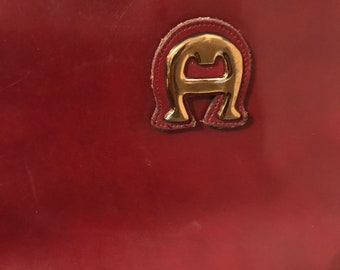 Vintage leather Etienne Aigner in Oxblood color with brass or goldtoned hardware!