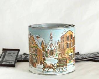 Vintage Hershey's collector's Christmas tin with Victorian winter village scene and chocolate chip cookie recipe on lid