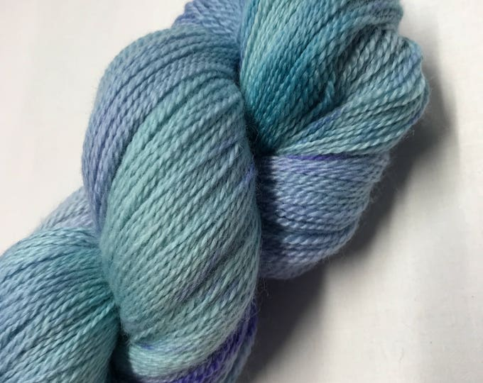 100g Extra fine merino / silk lace weight yarn, 80/20% 600 metres, hand dyed in scotland, lilac, turquoise, blue speckled