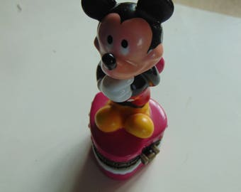 Mickey Mouse  hiding a Valentine for Minnie Mouse trinket box with  candy inside as trinket