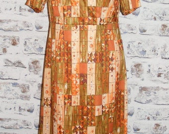 Size 12 vintage 60s short sleeve a line midi day dress orange crazy print (GX06)