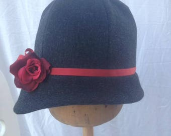 Grey wool cloche hat with red band and rose