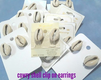 Cowry shell clip on earrings