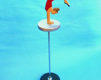 Circus Acrobat Handstand On High Pole Platform