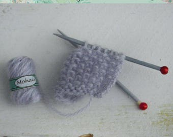 Miniature Knitting project work in progress ( with skein of mohair and needle )
