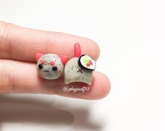 Cute cat earrings and tuna sushi roll