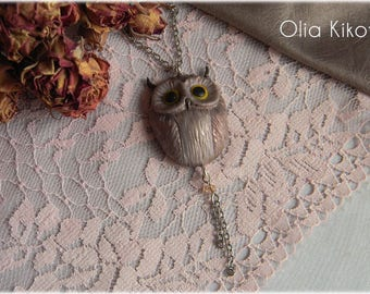 Suspended owl handmade from polymer clay. Pendant owl is a symbol of wisdom.