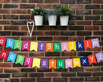ALPHABET A-Z banner/bunting child's room decoration. Learn letters and colours. Beautiful flag bunting 270gsm card