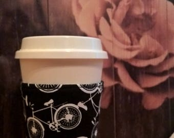 Bicycle disposable coffee cup sleeve. cozie eco friendly cozy.