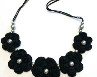 Necklace made of black cotton yarn and crochet with beads
