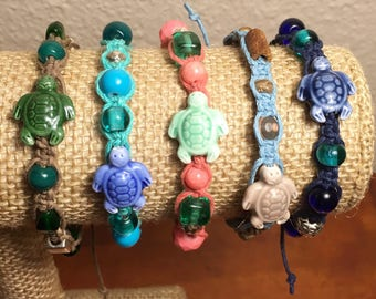 Adjustable hemp bracelet with ceramic sea turtle bead glass wood and silver plated beads