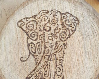 Elephant wood burning.