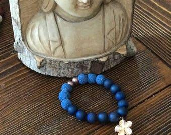 Blue Agate beaded healing bracelet w/blue lava rocks and gold filled plumeria flower charm