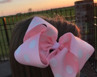 Pink hair bow with white polka dots