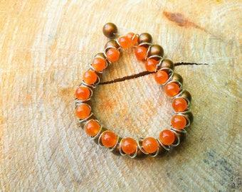 Rocky Shores - Beaded orange and brown elastic bracelet