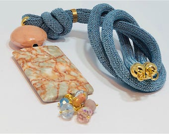 SALE blue cord long necklace with pink stones.