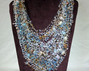 A necklace made of beads, glass pearls, swarovski crystals