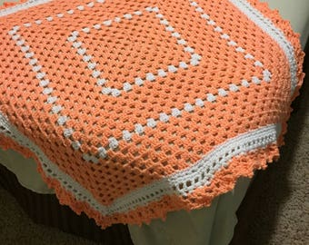 Orange and white baby afghan