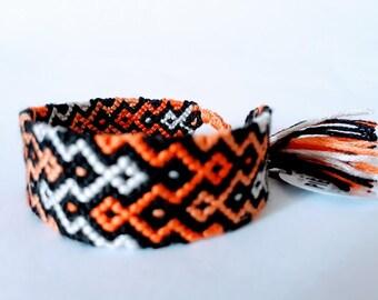 model: orange is the new black (friendship bracelet 18 threads)