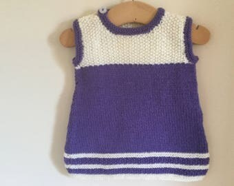 Hand knitted, acrylic tunic dress with button fastening at neck for easy pull on.