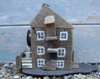 Water mill made from driftwood collected from Solent beaches and mounted on slate
