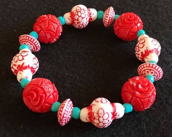 Red and white floral bracelet with turquoise accent