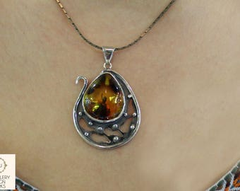 Silver Necklace decorated with Amber