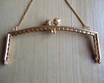 Bag in gold metal clasp