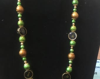 Typewriter keys gold and green beaded necklace
