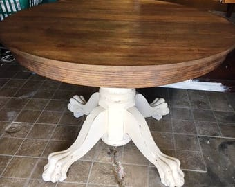 Antique refinished claw foot round dining table