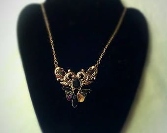 This one of a kind necklace has faux onyx and gold