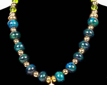 Bellezura.  I designed this beautiful necklace with a combination of amazing stone Turquoise and green beads and goldfilled pendant