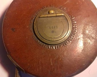 Vintage tape measure.1950s Made in Sheffield England  Brown leather stiched casing