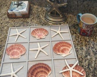 Tic Tac Toe board, beach, starfish, fan shell, sand dollar, wood